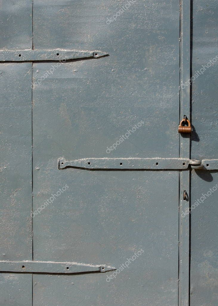 Texture, pattern, background. Old doors painted with black paint, with an ancient castle