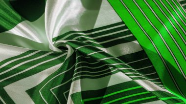 Texture,  silk fabric with a green striped pattern. The design o
