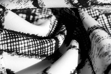 texture, background, pattern. white fabric with black abstract f