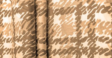 Background design texture, sandy sepia yellow silk fabric, abstraction, copyright print, military camouflage fleece fabric, your designs will allow you to be military,