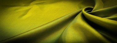 texture, background, pattern, pattern, chocolate, silk fabric, tight weaving, photo studio. Green, green-yellow, chartreuse fabric color, the play of light and shadow make this photograph unique,