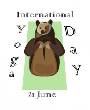 Concept on the International Yoga Day on June 21, the bear engages in yoga