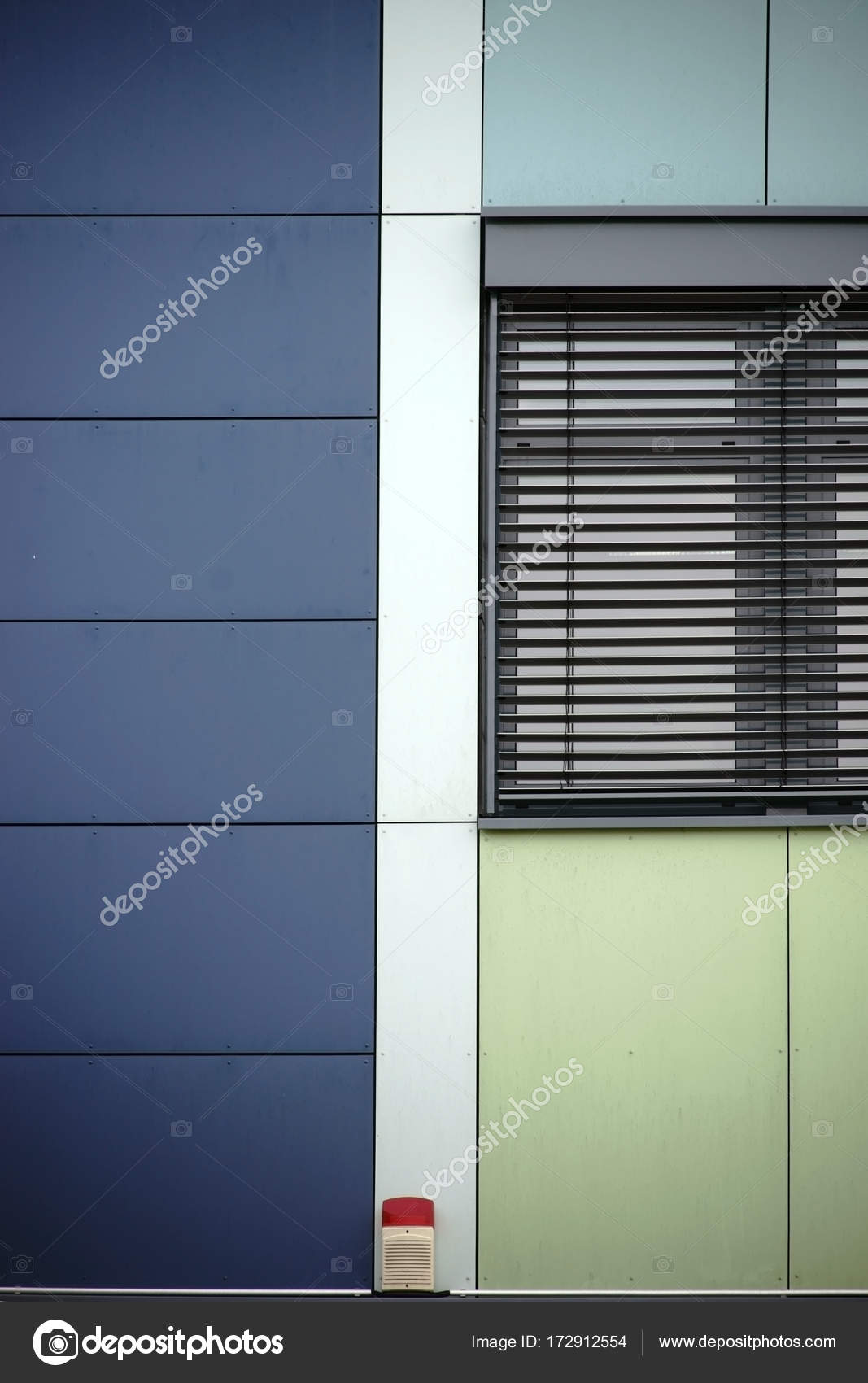 Modern house facade with alarm system stock photo