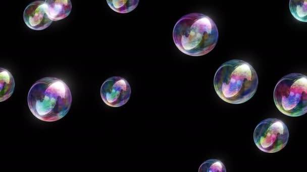 Mýdlové bubliny 4k / / 4 k barevné zábavné Video na pozadí smyčky. Mýdlové bubliny. Mnoho z nich. Vykresleny před černým pozadím, takže toto video smyčky lze snadno použít ve spojení s projektorem.