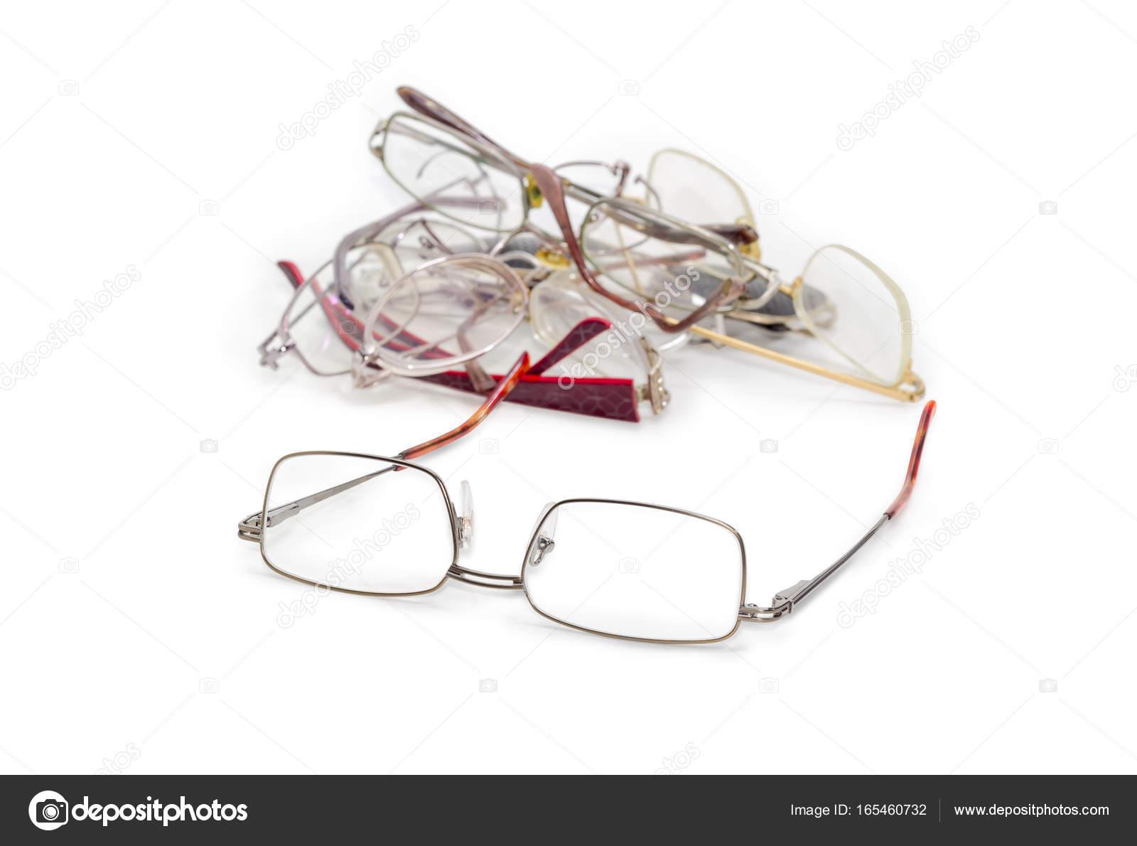 Modern classic mens eyeglasses against of old glasses — Stock Photo ...