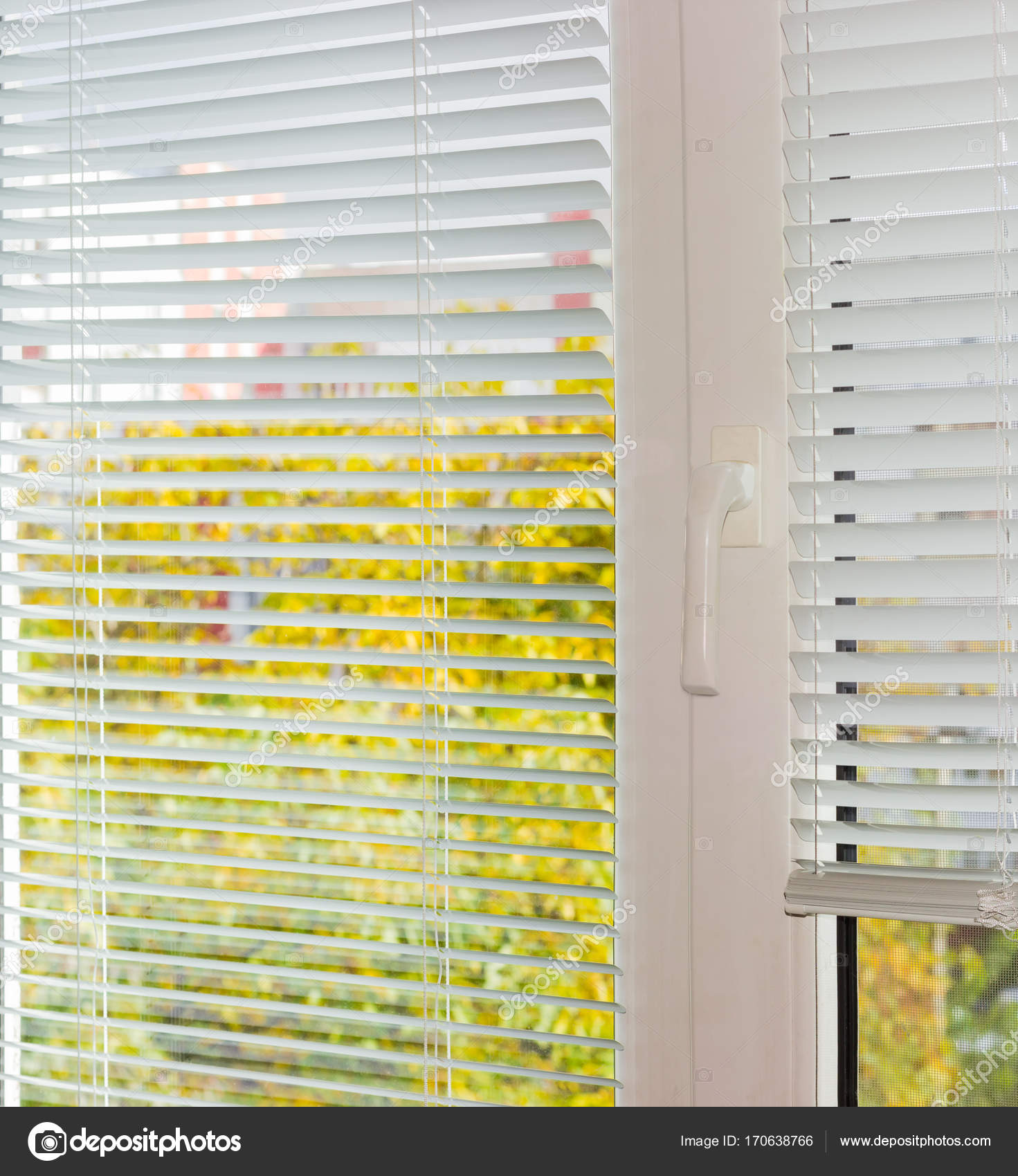 plastic window blinds faux wood white venetian blinds on plastic window in autumn day stock photo