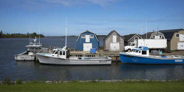Fishing sheds and boats at dock, Green Gables, Prince Edward Island, Canada