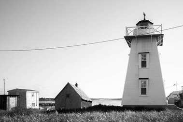 Lighthouse and sheds at North Rustico, Prince Edward Island, Canada