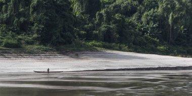 Man along side a boat in River Mekong, Sainyabuli Province, Laos