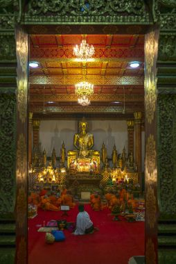 Monks in Wat Nong Sikhounmuang temple, Luang Prabang, Laos