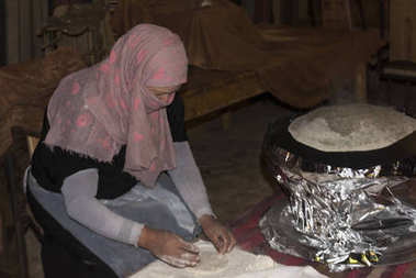 Woman making rumali roti, Judean Desert, Dead Sea Region, Israel
