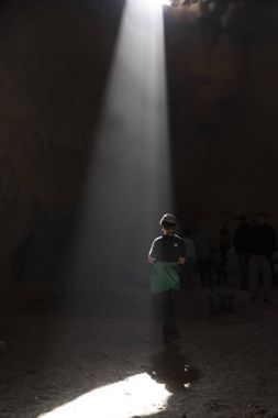 Sunlight falling on person standing in cave, Masada, Judean Desert, Dead Sea Region, Israel