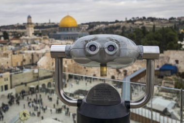 Close-up of coin-operated binoculars with Western Wall and Dome of the Rock in the background, Old City, Jerusalem, Israel