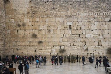 People praying at the Wailing Wall with dome of the rock in background, Old City, Jerusalem, Israel