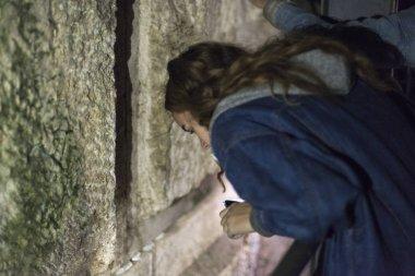 Teenage girl praying at Western Wall, Old City, Israel