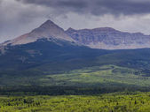 Photo View of landscape with mountain range in the background, Glacier National Park, Glacier County, Montana, USA