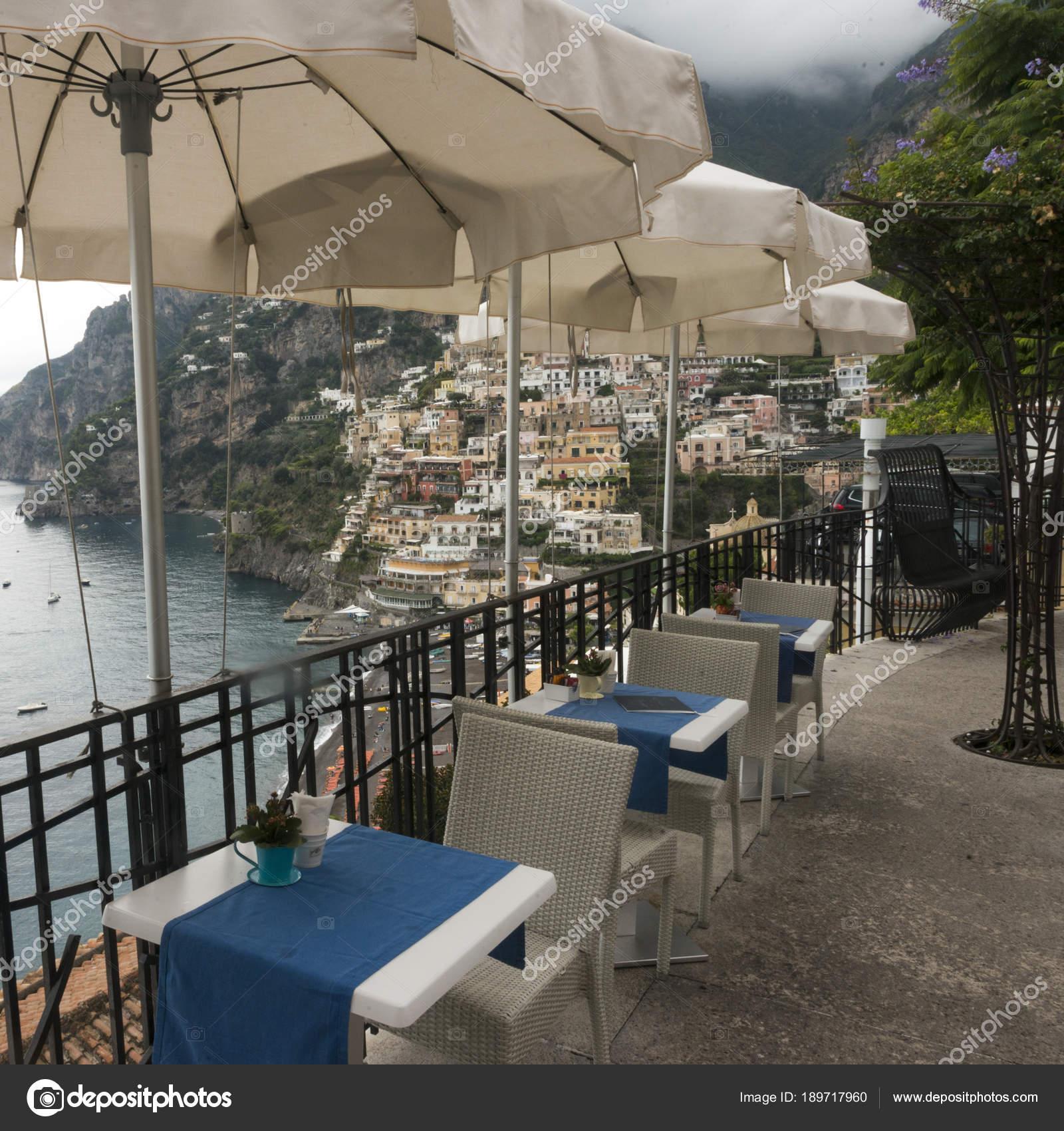 Empty Chairs Tables Patio Umbrellas Terrace Positano Amalfi Coast Salerno Stock Photo C Klevit Shaw Ca 189717960