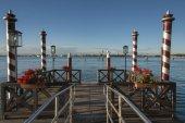 Mooring poles and pier in Venetian Lagoon, Cannaregio, Venice, Veneto, Italy