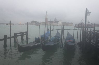 Gondolas moored in Grand Canal with Church of San Giorgio Maggiore in the background, Venice, Veneto, Italy