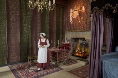 Maid in bedroom of royal palace, Stirling Castle, Stirling, Scotland