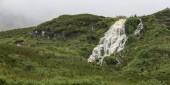 Low angle view of waterfall, Portree, Isle of Skye, Scottish Highlands, Scotland
