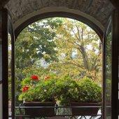 Fotografie Open window showing flowers in window box , Radda in Chianti, Tuscany, Italy