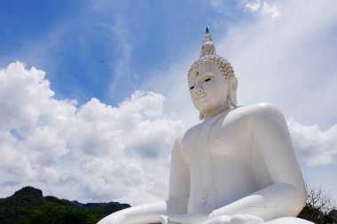 White Buddha With the blue sky, beautiful clouds in bright days.