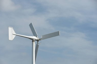 Wind power station on sky background