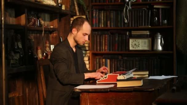 The man works on a typewriter