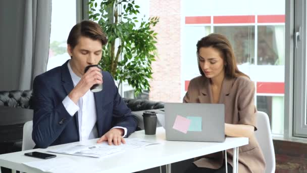 businessmen and businesswomen meeting brainstorm ideas about new paperwork project colleague working together planning success strategy enjoy teamwork in small modern night office. 4k Slow motion