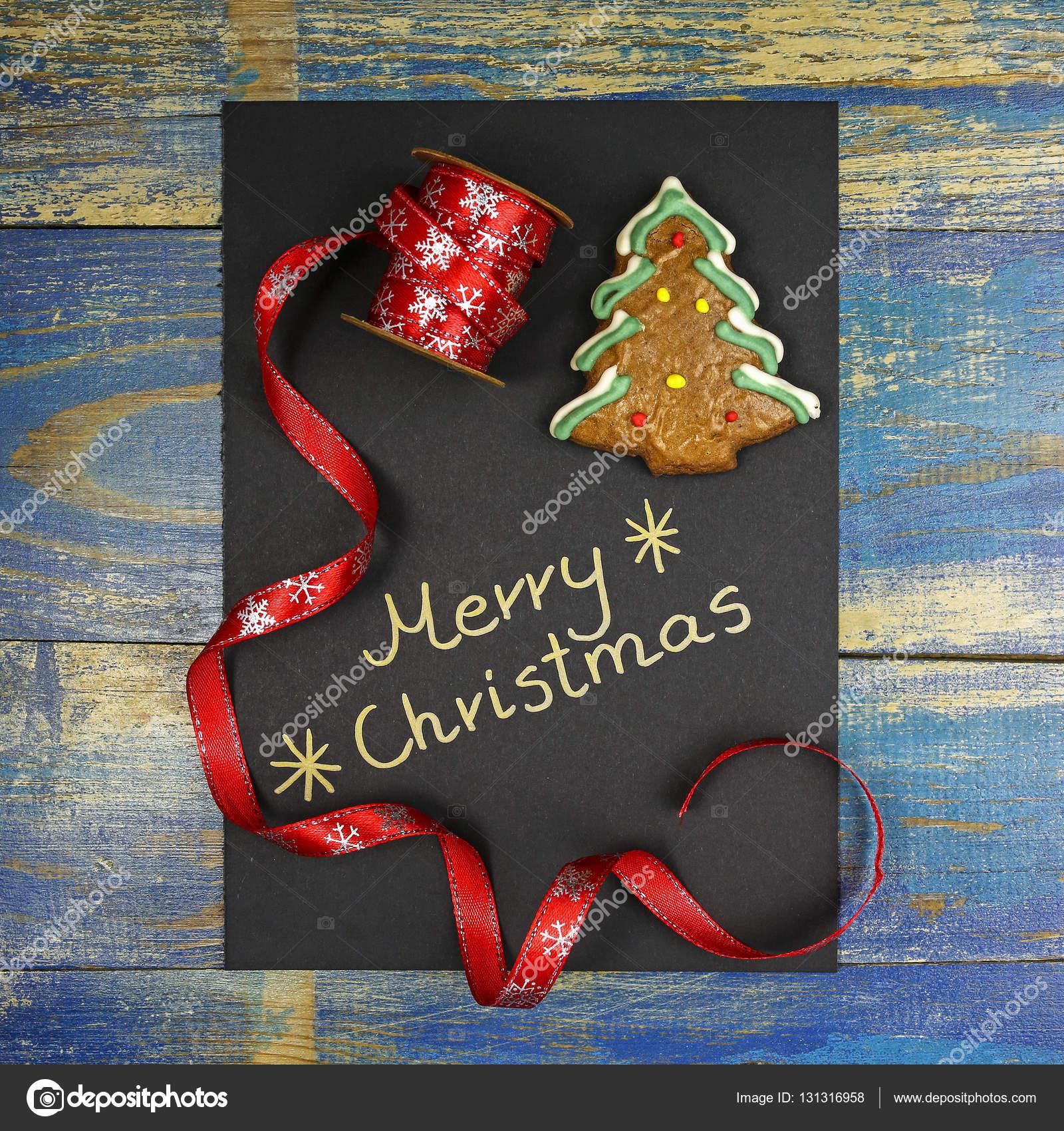 Frohe Weihnachten Band.Frohe Weihnachten Auf Schwarzem Karton Mit Lebkuchen Und Weihnachten