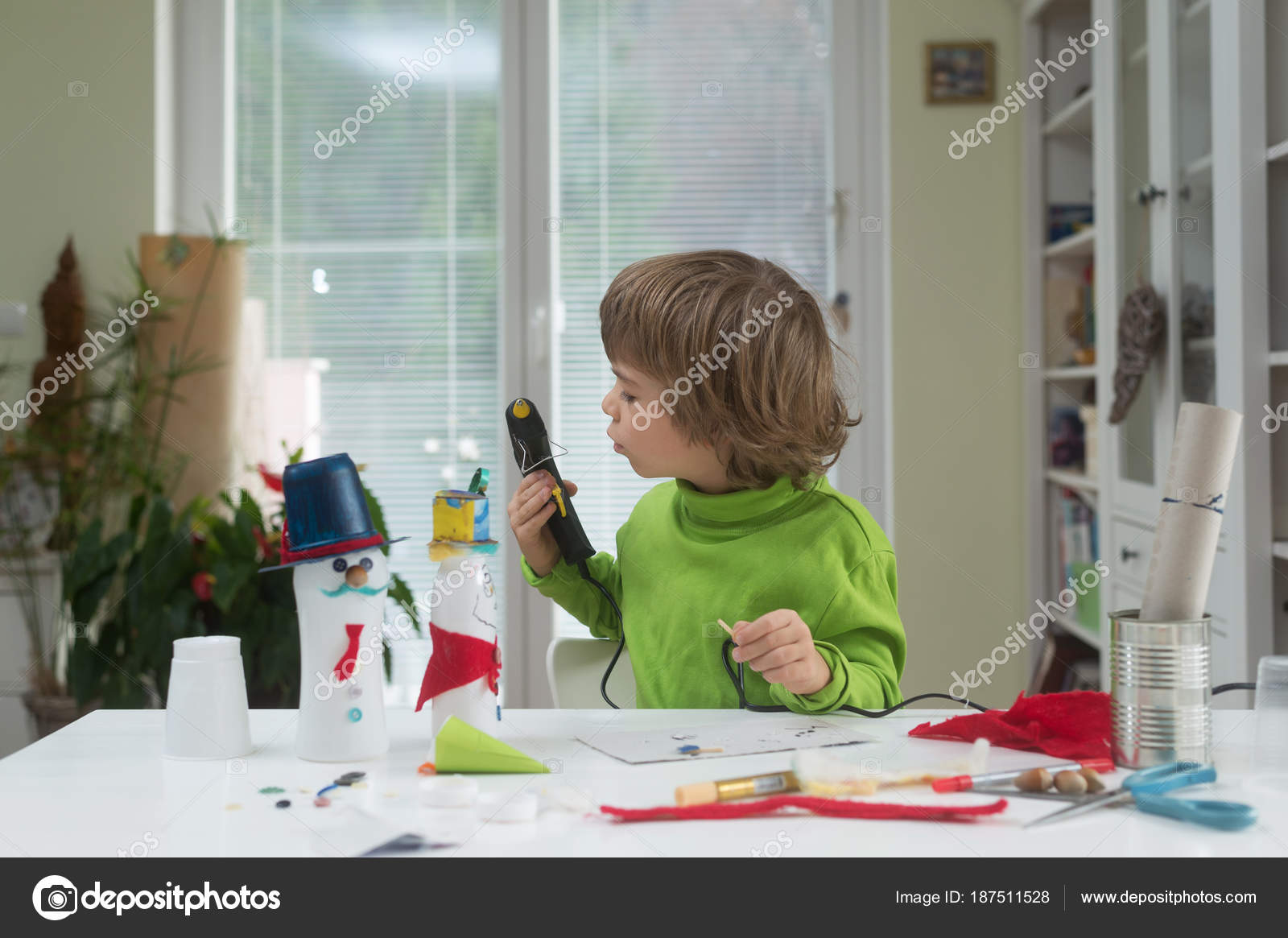 Little boy being creative making homemade yourself toys out yogurt little boy being creative making homemade do it yourself toys out of yogurt bottle and paper using hot melt glue gun supporting creativity learning by solutioingenieria Image collections