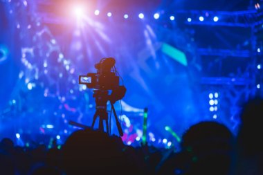 Cameraman shooting video production camera videographer in concert music festival stock vector