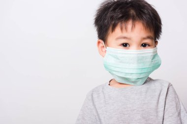 Closeup Asian face, Little children boy sick he using medicine healthcare mask on white background with copy space, health medical care