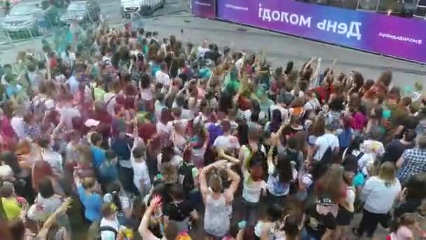 aerial of Holi colours festival in slow motion. people throwing colourful powder in the air