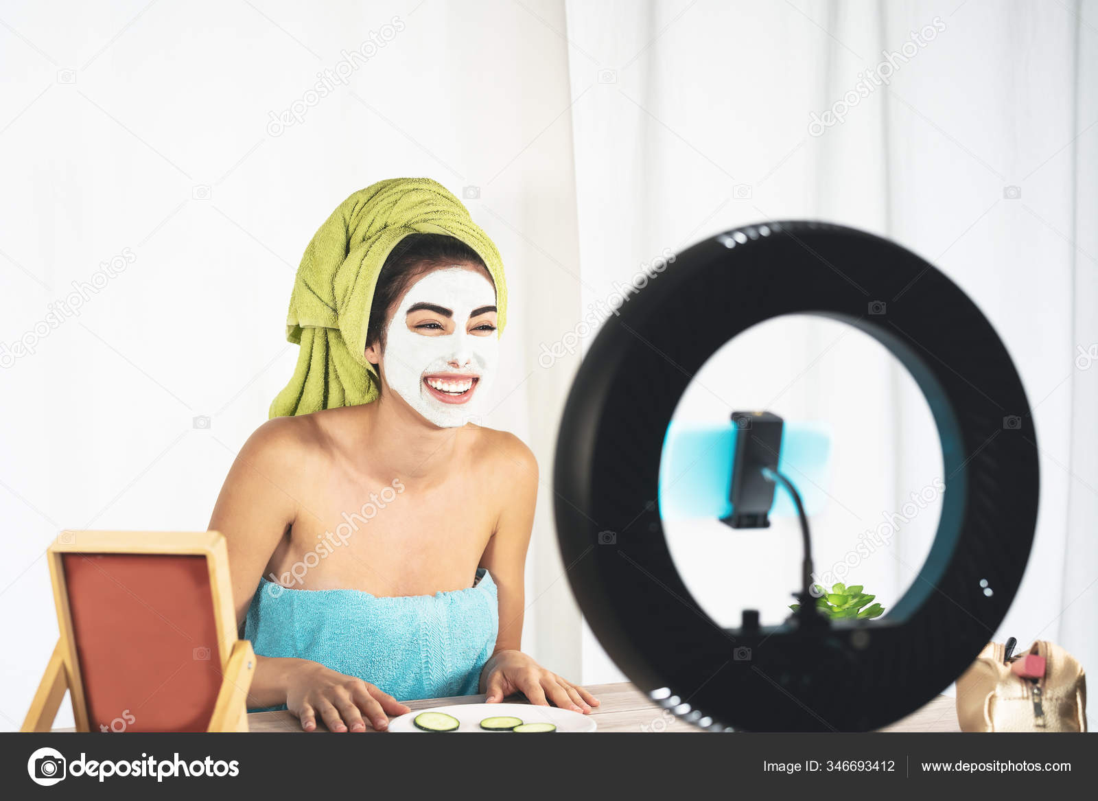 Young Female Vlogger Applying Skincare Facial Mask While Recording Video Stock Photo C Alessandrobiascioli 346693412