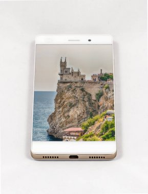 Modern smartphone displaying picture of Swallow's nest castle, Yalta, Crimea