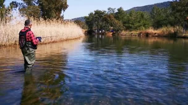 Hisaronu Orhaniye, Marmaris - Mugla / Turkey. March 12, 2020. Trout hunt between reedy. in Hisaronu.Bass hunt between reedy in Hisaronu. Fishing in a sunny day.