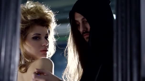 Seductive couple with perfume oil