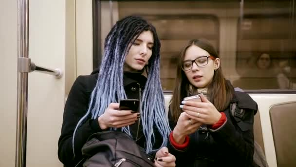 Girl With Dreadlocks Is Going By Metro With Her Friend Teens Are