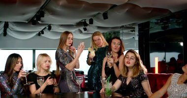 female friends are toasting and cheering young woman on party