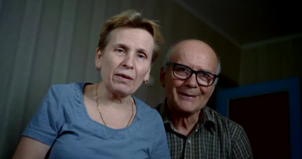 aged married couple is communicating by video call, looking at camera, portrait