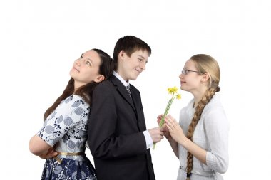 Boy gives flowers to girlfriend