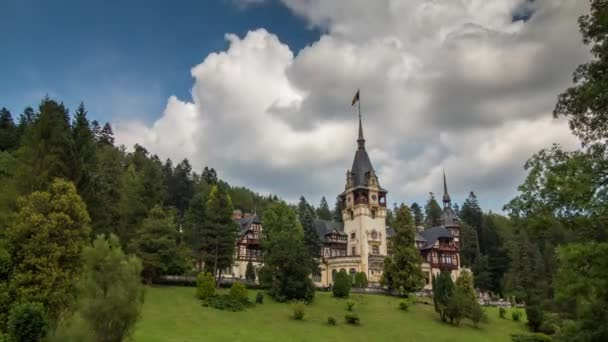 Clouds moving above Peles Castle .The castle is surrounded by green forest
