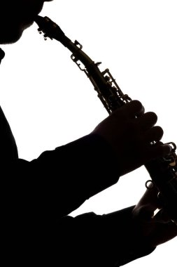 saxafon on a white background in the hands of a musician silhoue