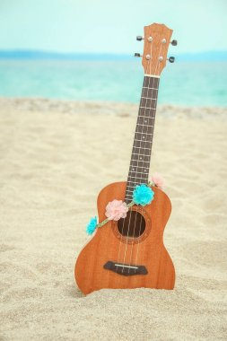 beautiful guitar on the sand by the Greek sea