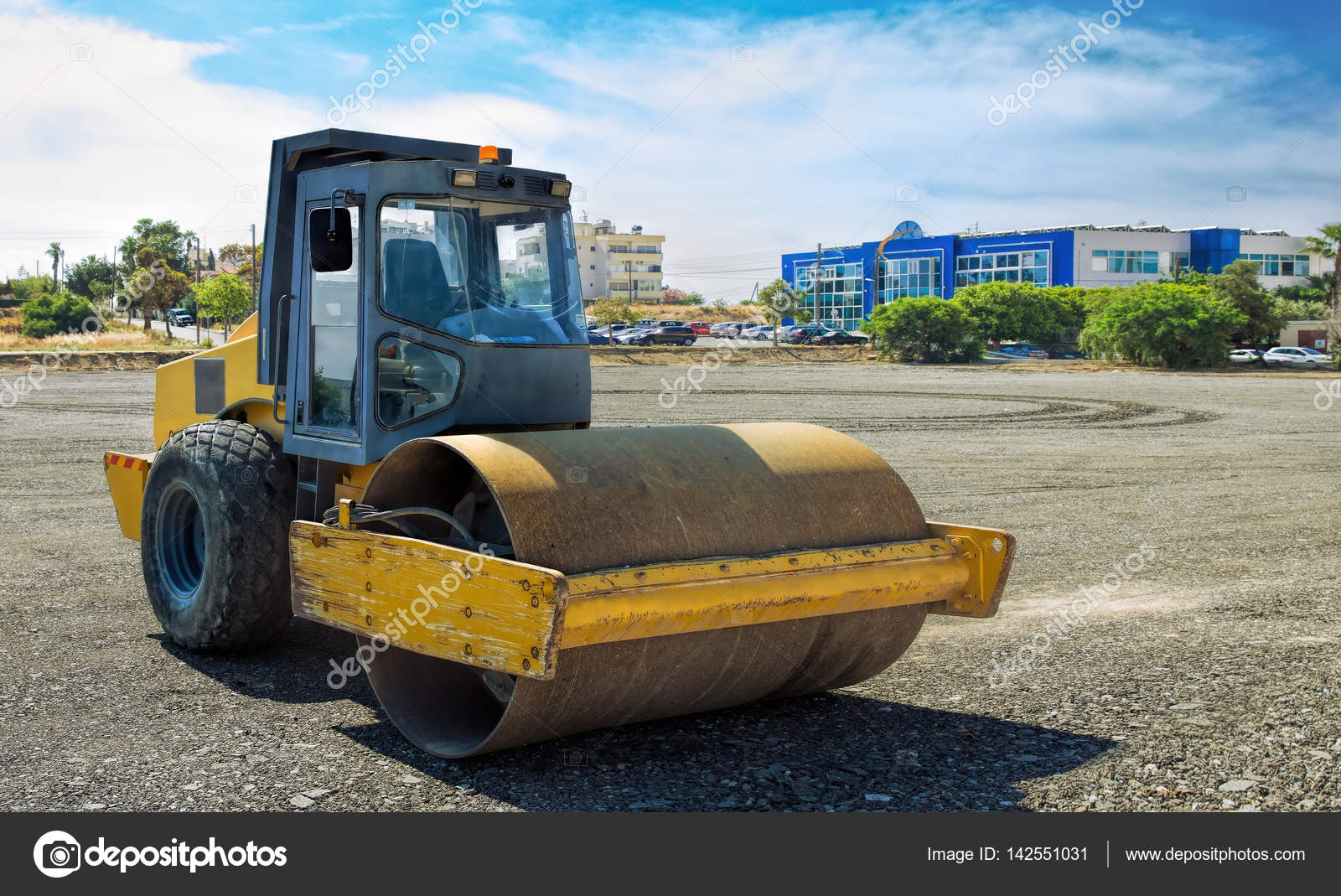 roller compactor machine flattens the asphalt stock photo