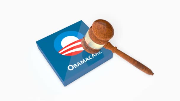 Plate with Obama Care affordable healthcare act logo being crashed with Judges Gavel (Hammer).
