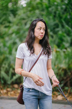 Portrait of a young Pan Asian woman in a park in the summer.