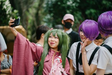 Singapore, March 2018: Young cosplayers dress up as Japanese Anime and Manga characters for Sakuta Matsuri in the Flower Dome within Gardens by the Bay in Singapore.